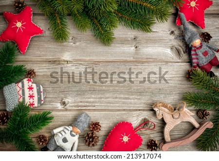 Christmas background with festive decoration and toys over wooden board