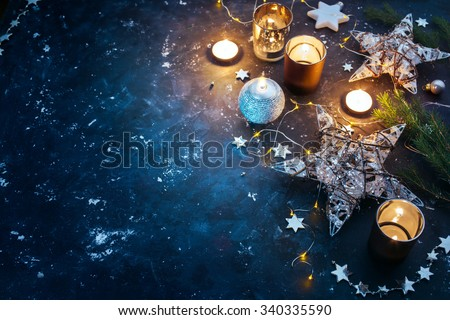 Christmas background with festive decoration, stars and candles. Christmas background with copyspace #340335590