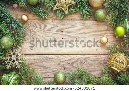 Christmas background with fir branches and decorations. Space for text. Top view.