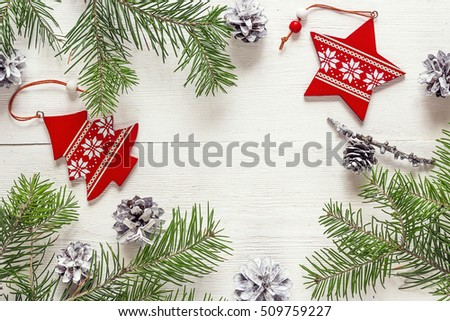 Christmas background with fir branches, pine cones and ornaments on white boards. Space for text. Top view. #509759227