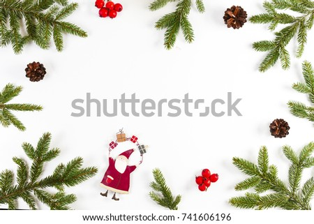 Christmas background with fir branches, pine cones, red berries and Xmas decoration on white background #741606196