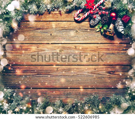 Christmas background with fir tree and decoration on dark wooden board #522606985