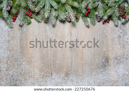 Christmas background with fir tree on old wooden board - Shutterstock ID 227250676