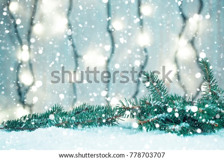 Christmas background with garland, Christmas tree branches, snow and decorations on wooden table - Shutterstock ID 778703707