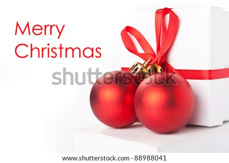 Christmas background with gift boxes and red balls