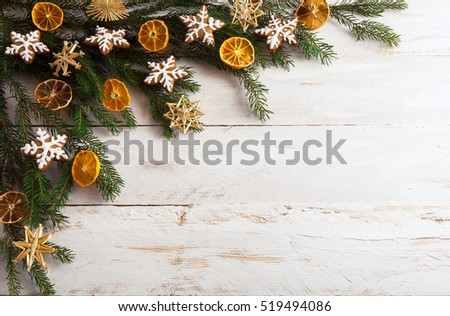 Christmas background with gingerbread cookies and dried orange slices. New year greeting card. Copy space. #519494086