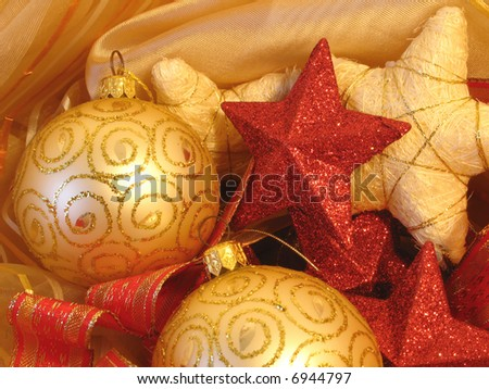Christmas background with golden balls, stars and red ribbons