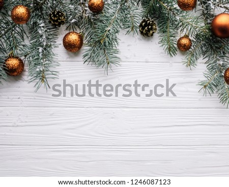 Christmas background with golden decoration on white wooden board #1246087123
