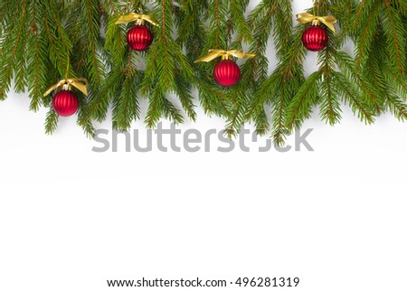 Christmas background with green tree branches on wood, red balls and golden ribbons #496281319