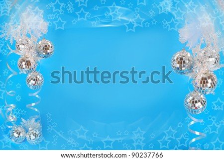 christmas background with mirror balls and star shapes in blue color