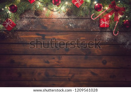 Christmas background with ornaments and gift boxes on the old wooden board #1209561028