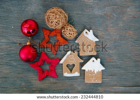 Christmas background with ornaments and gingerbread cookies on wooden table #232444810