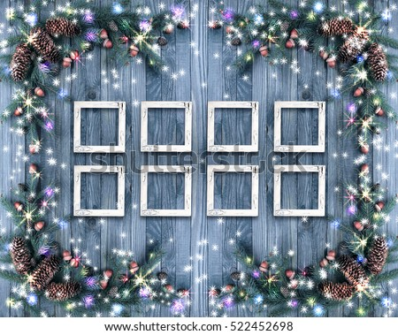 Christmas background with photo frames, illumination, glowing stars, spruce branches, pine cones, acorns. Winter holidays concept.