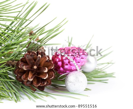 Christmas background with pink decoration and pine branch