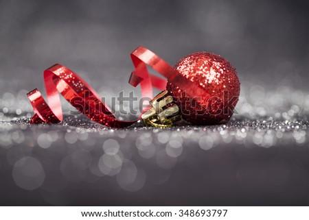Christmas background with red Christmas ball and holiday lights