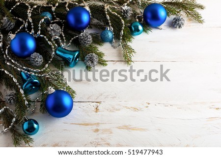 Stock Photo Christmas background with silver pinecone and blue ornaments. New year party decoration with shiny balls. Copy space.