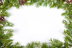 Christmas background with snow, and cones isolated on white