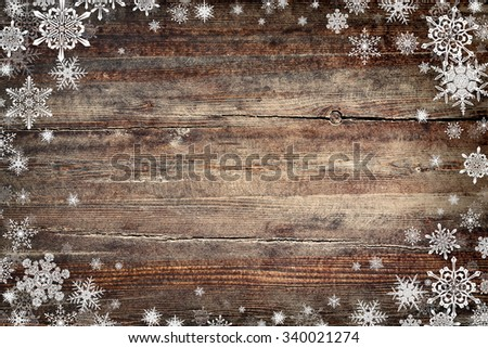 Christmas background with snowflakes and wooden texture