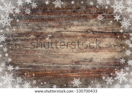 Christmas background with snowflakes on wooden texture #530700433