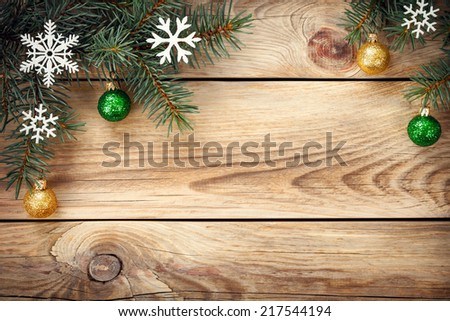 Christmas background with spruce tree, snowflakes and christmas balls on table. Copy space. Top view