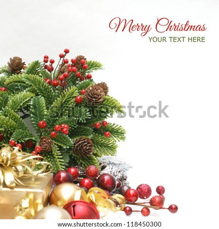 Christmas background with wreath, gift, berries and baubles - focus on the wreath