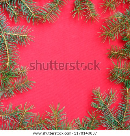 Christmas background with xmas tree on red canvas background. Merry christmas card. Winter holiday theme. Happy New Year. Space for text #1178140837