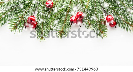 Christmas background with xmas tree, red berries on white wooden background. Merry christmas greeting card, frame, banner. Winter holiday theme. Happy New Year. Space for text. Flat lay. Snow effect. #731449963