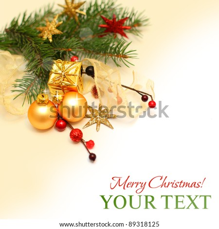 Christmas background - Xmas gift, gold decoration, red berry and fir branch