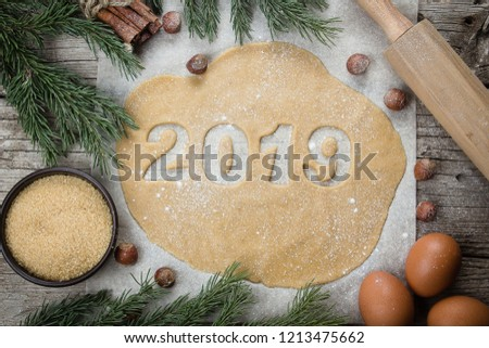 Christmas Bakery Concept. Gingerbread raw dough for Christmas cookies. Happy New Year 2019. Top view #1213475662