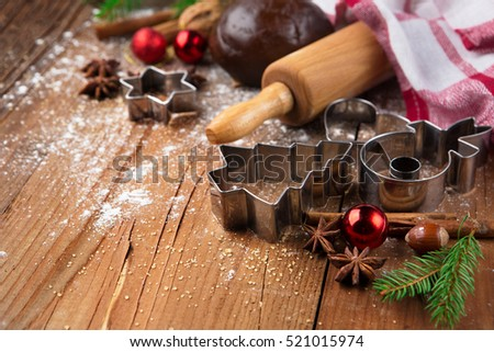 Christmas baking background with gingerbread dough, cookie cutters and spices. Winter holiday concept. Selective focus.