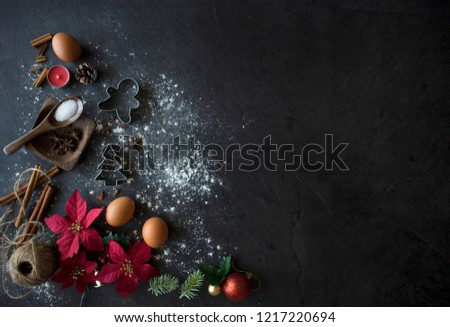 Christmas Baking Ingredients on Black Table, Christmas Flatlay on Dark Background with Copy Space. Christmas Cake Ingredients Top Down Shot #1217220694