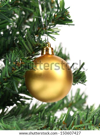 Christmas ball and green spruce branch