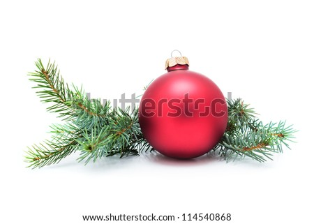 Christmas ball and green spruce branch, isolated white background