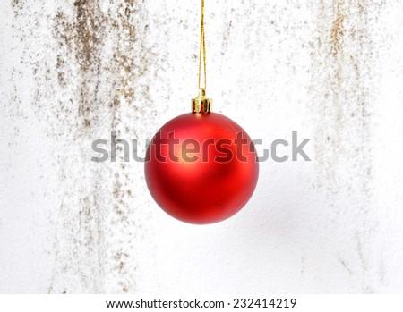 Christmas ball hanging on grunge background