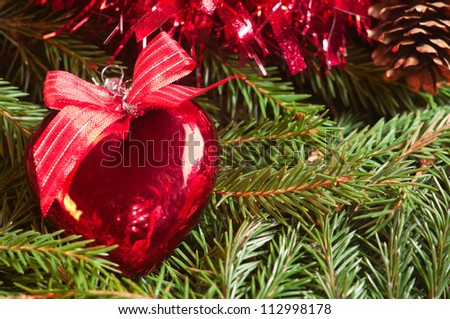 Christmas ball (heart) on tinsel background