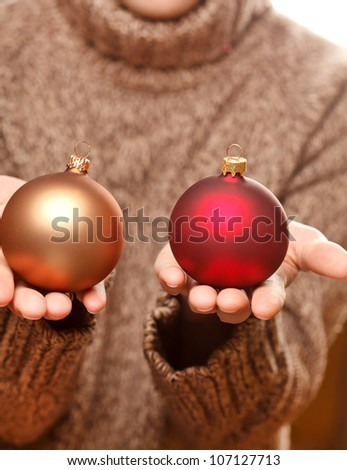 christmas ball in the hands - stock photo