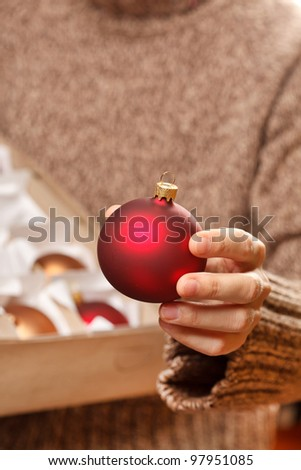 christmas ball in the hands