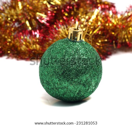 Christmas ball on green background of holiday decorations