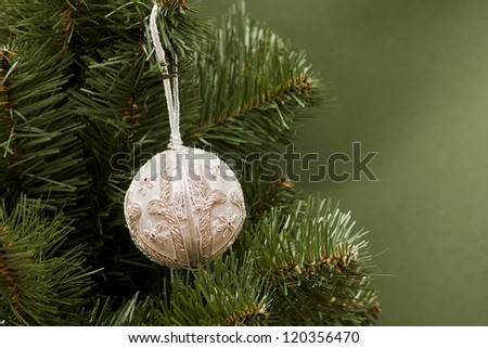 Christmas ball on green spruce