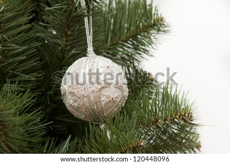 Christmas ball on green spruce