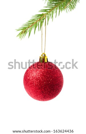 christmas ball on green spruce branch - isolated