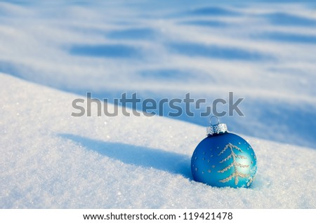 Christmas ball on the snow drifts