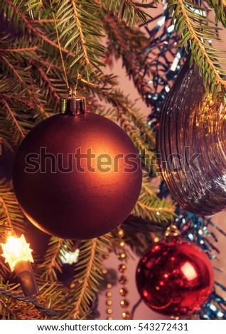christmas ball on the tree a lump and a burning christmas tree garland vintage