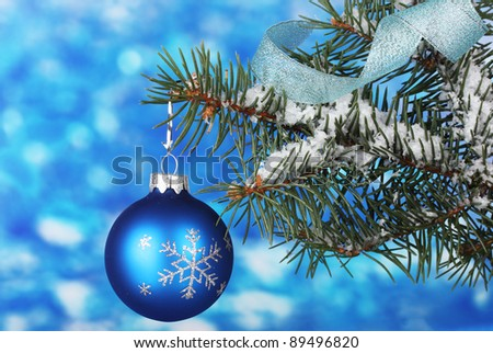 Christmas ball on the tree on blue