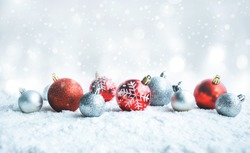 Christmas ball (ornament) on snow background.For christmas day concepts or new year,celebration ideas.copy space