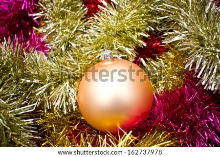Christmas ball texture on shiny reflecting colorful chain texture