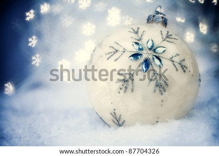 Christmas ball with Blue Holiday Background.