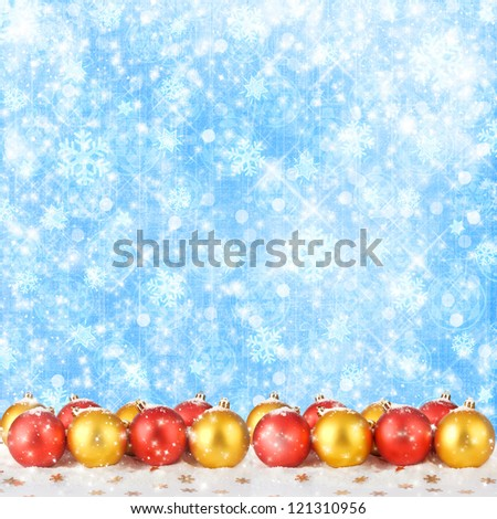 Christmas ball with greeting card on the abstract sparkling background