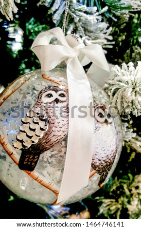 Christmas ball with ribbon. Christmas tree decorations and decorations in the design.