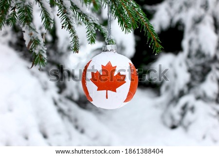 Christmas ball with the Canadian symbol on the flag, decorates the snow tree. Photo stock ©